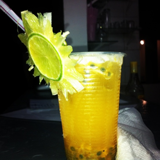 A passion fruit Caipirinha sporting a pretty lime garnish.